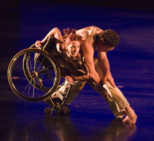 Photo of AXIS Dancers, one in wheelchair