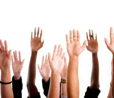 photo of hands up (voting)