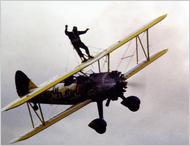Photo of Tom Lackey, wing-walking (Caters News, Bulls press, New York Times)