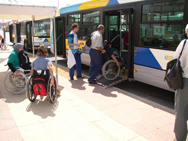 Wheelchair user enter bus at Athens Paralympic Games 2004