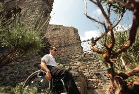 accessible tourism image of wheelchair user in natural landscape by CPD, Italy