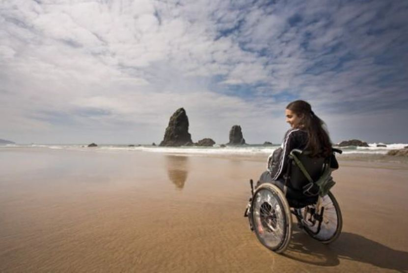 Image of girl in wheelchair on beach