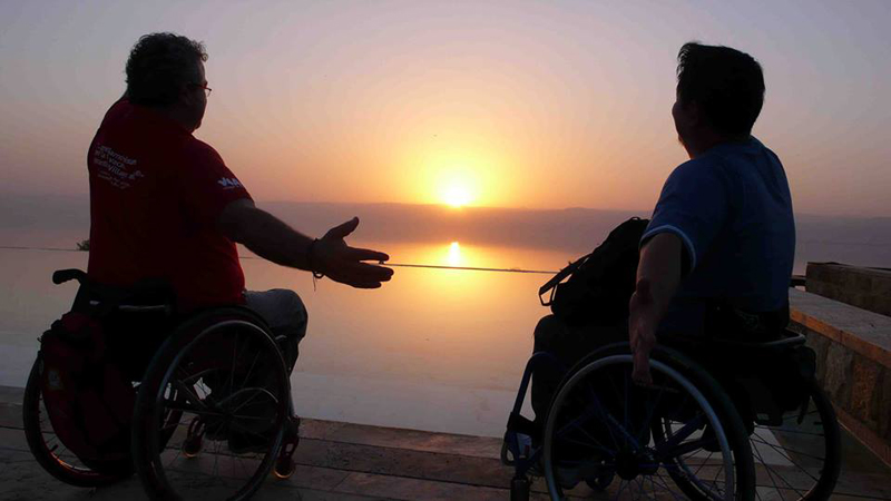 Jordan Dead Sea sunset with visitors and wheelchairs