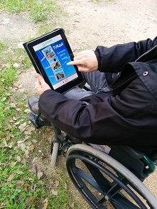 Photo of wheelchair user with PREDIF's app.