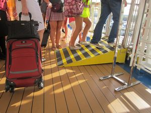 Image of ramp and suitcase with wheels at Barcelona passenger port by John Sage