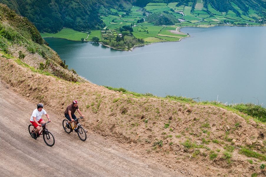 Azores view of mountains, lake and cyclists