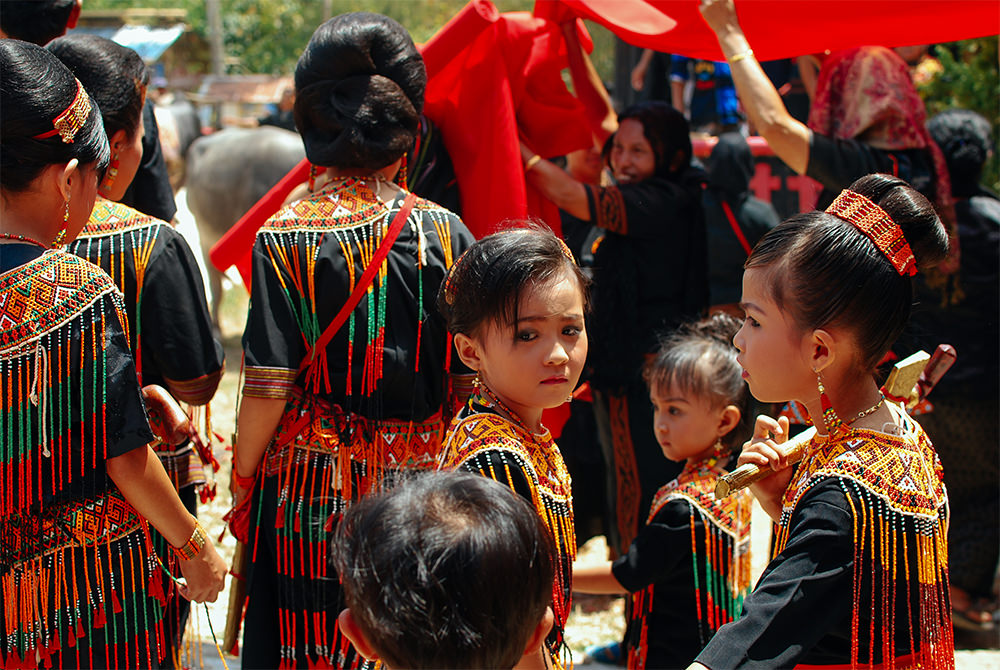 Toraja kids in traditional dress, Sulawesi (Accessible Indonesia)