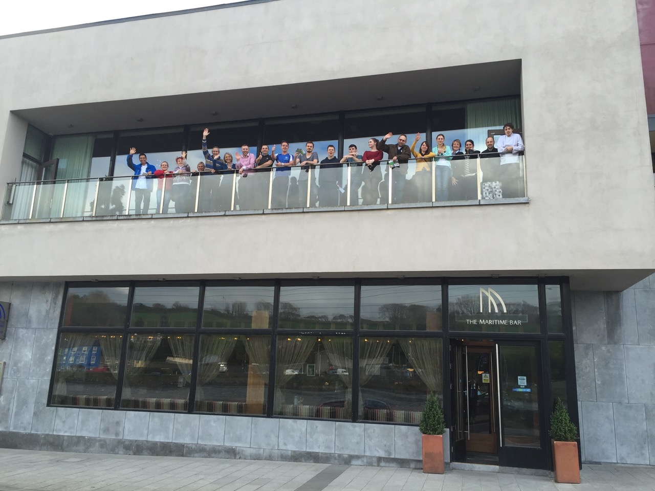 Staff trainees of the Quality Programme, waving on balcony, Maritime Hotel, Bantry, Ireland