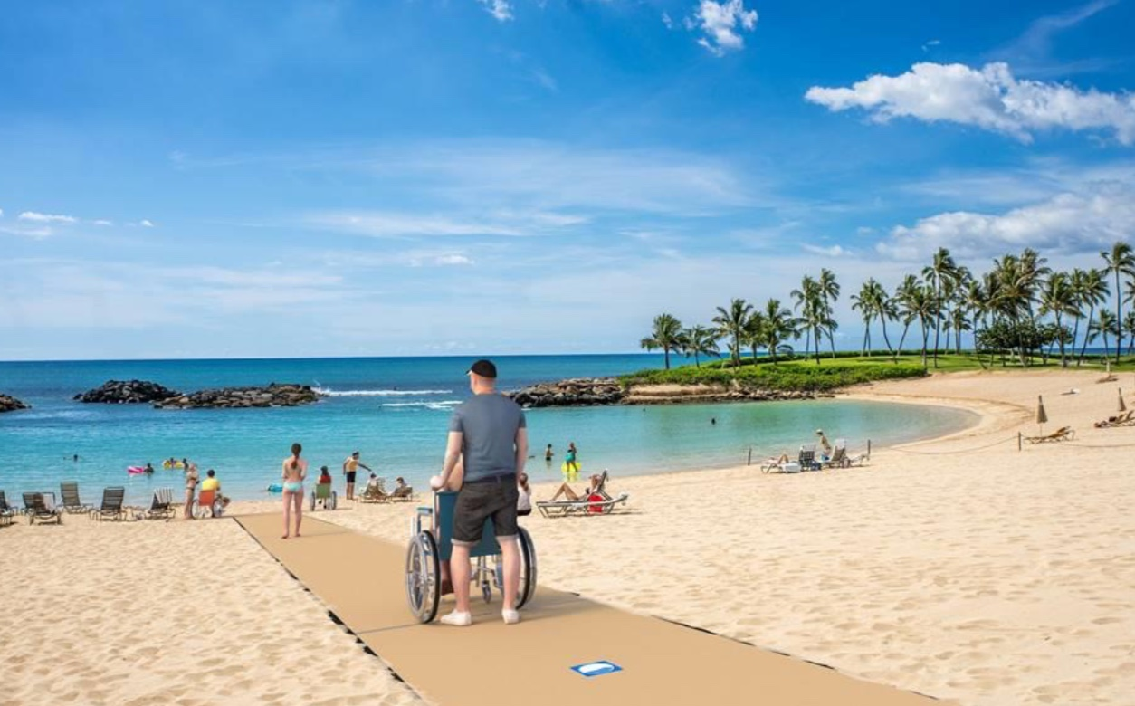 Image of universal access beach mat and wheelchair user on tropical beach