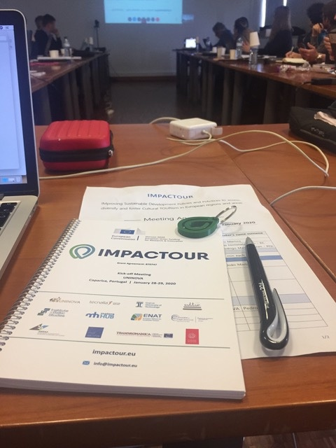 IMPACTOUR image of notebook with pen in meeting room